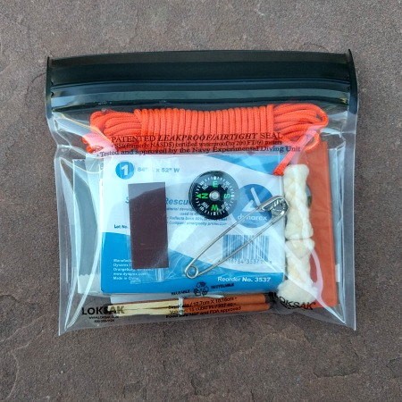 waterproof survival kit, fire starter, ten essentials
