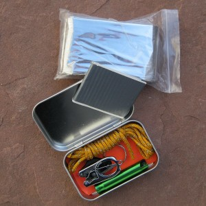 Mini Tin contains survival gear for starting a fire, signalling, shelter, light, and basic first aid - all in the size of a pack of Altoids.