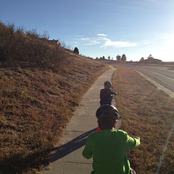 kid bike ride into the sun